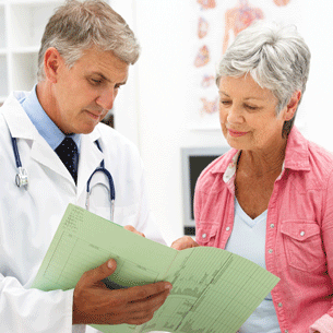 Physician talking to diabetes patient